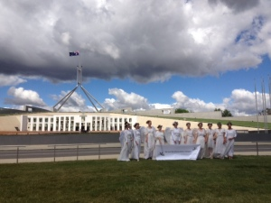 A bank of ominous cloud rolls in as Tony Abbott tables his Carbon Price Repeal Legislation