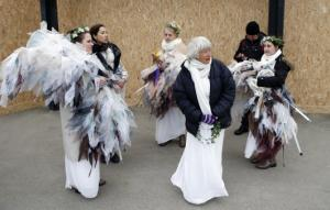 """Members of """"Climacts Angels Guardians"""" from Australia gather at the entrance of the COP21, United Nations Climate Change Conference, in Le Bourget, outside Paris, Monday, Nov. 30, 2015. (AP Photo/Francois Mori)"""