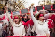 12 Dec 2015, Paris, France --- Paris, France. 12th December 2015 -- Climate campaigners dressed as angels led the protest against climate change on the Avenue de la Grande Armee, Paris. -- Climate protesters blocked the Avenue de la Grande Armee and then marched to the Eiffel Tower, to highlight the need for a binding climate emissions agreement at the COP 21 meeting of nations in Paris. --- Image by © Jo Syz/Demotix/Corbis