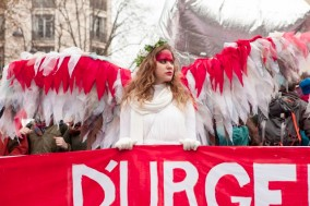 12 Dec 2015, Paris, France --- Paris, France. 12th December 2015 -- Climate campaigners dressed as angels led the Red Lines climate protest on the Avenue de la Grande Armee, Paris. -- Climate protesters blocked the Avenue de la Grande Armee and then marched to the Eiffel Tower, to highlight the need for a binding climate emissions agreement at the COP 21 meeting of nations in Paris. --- Image by © Jo Syz/Demotix/Corbis