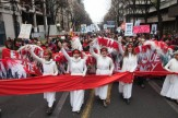 12 Dec 2015, Paris, France --- Guardian angels of the climate holds up a red line symbolizing panetary boundries in front of estimated 15,000 demonstrators who marsched from Avenue De La Grande Armée to the Eiffel Tower during the D12 demonstrations during the last day of COP21 in Paris, France, on Decembe 12th, 2015. (Photo by Andre Larsson/NurPhoto) --- Image by © Andre Larsson/NurPhoto/Corbis