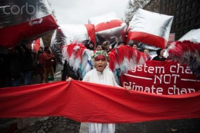 12 Dec 2015, Paris, France --- Guardian angels of the climate holds up a red line symbolizing panetary boundries in front of estimated 15,000 demonstrators during the D12 demonstrations during the last day of COP21 on Avenue De La Grande Armée in Paris, France, on Decembe 12th, 2015. (Photo by Andre Larsson/NurPhoto) --- Image by © Andre Larsson/NurPhoto/Corbis