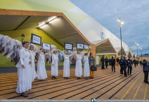 Climate Guardians from Australia Climacts.org.au at entrance to COP21 on the first day, reminding delegates of their duties — while civil guardians of the event security team stand watch also. Oldest is 17 year old June Norman is a mother of five, a grandmother of eight and a great-grandmother of three children. She is the first person in Australia to have been arrested for taking direct action against gas fracking.