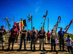 NoDAPL-holding_the_line-courtesy_honor_the_earth